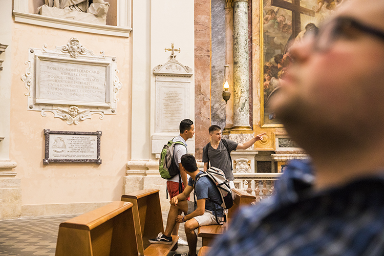 Students browsing museum in Rome