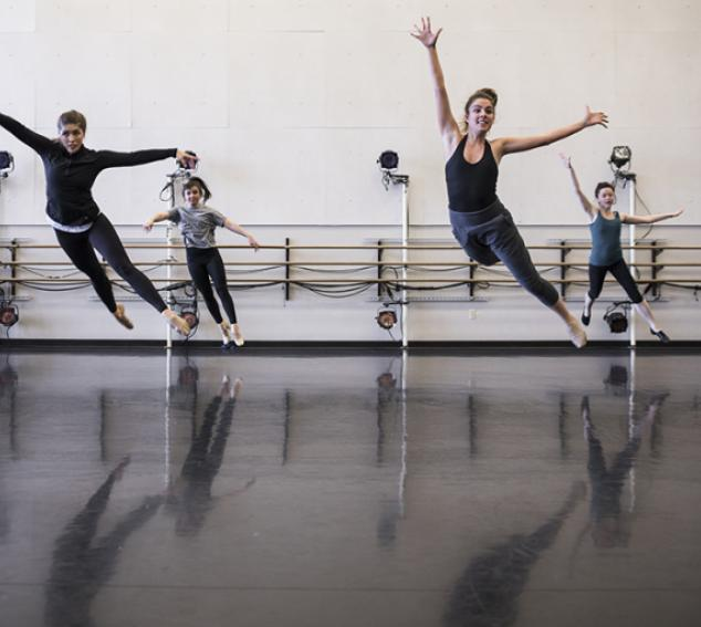 4 dance students jumping into the air