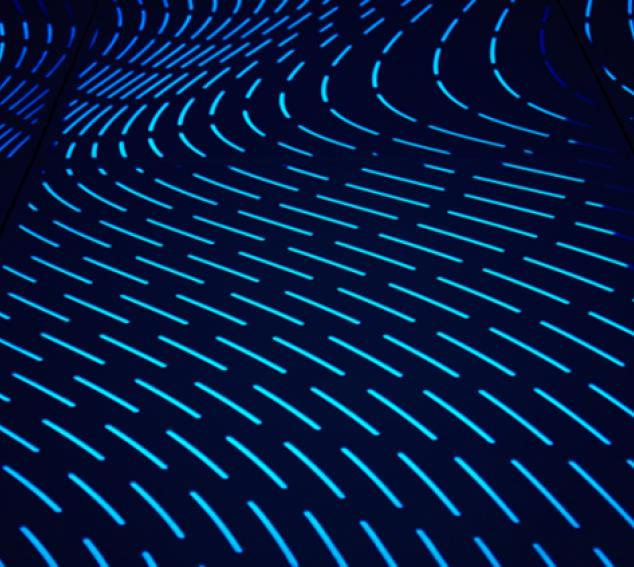 Angular blue lights in a wavy pattern on a wall