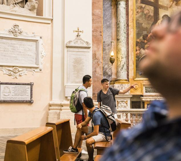 Image of four students studying art in a museum